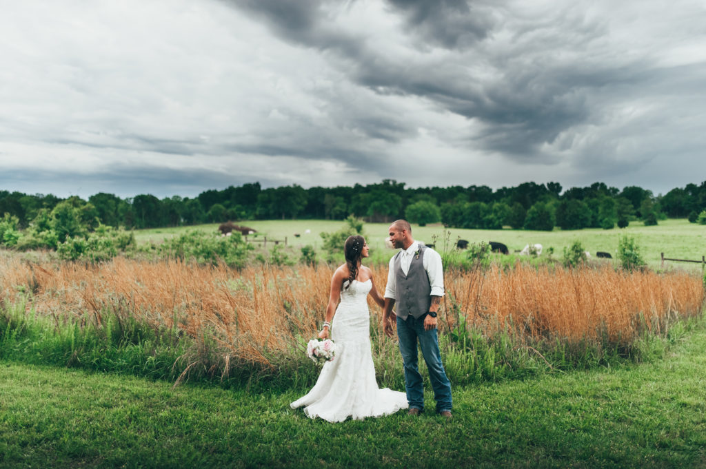 Couple in the fields at Iriswoods
