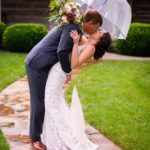 Newly Weds Kidding Under An Umbrella